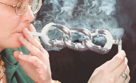 Person smoking a cigarette that looks like a chain