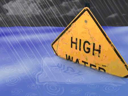 High Water road sign half-submerged in water as rain falls