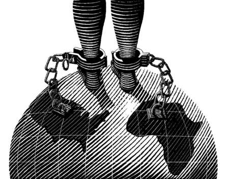 Chained feet standing on globe
