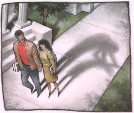 Couple holding hands with the shadow of the man attacking the woman