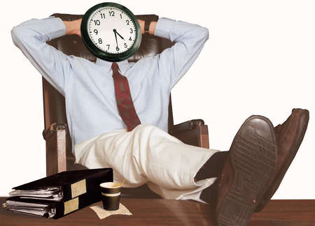 Man leaning back with feet up on desk; clock on his face says 04:30