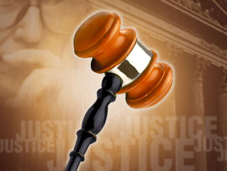 Gavel superimposed background of a courthouse, the word 'justice'