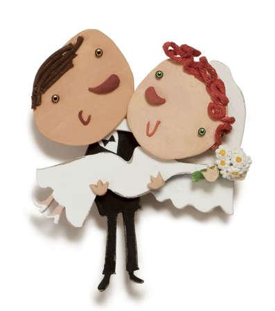Happy groom carrying bride