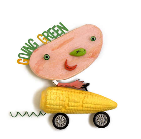 Man driving corn car with 'Going Green' text overhead