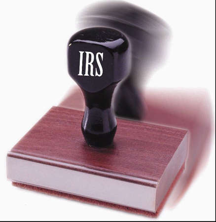 Rubber stamp labeled 'IRS'
