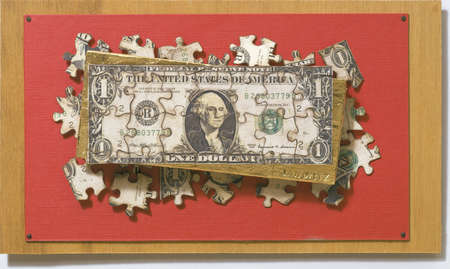 Jigsaw pieces forming dollar bill