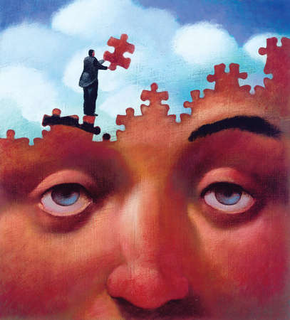 Man assembling jigsaw puzzle of human face