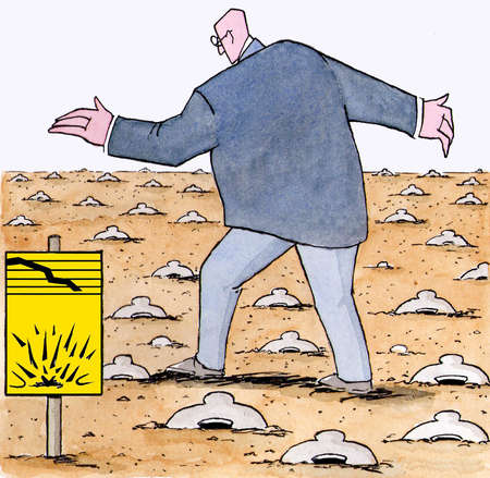 Businessman walking among piggy bank land mines