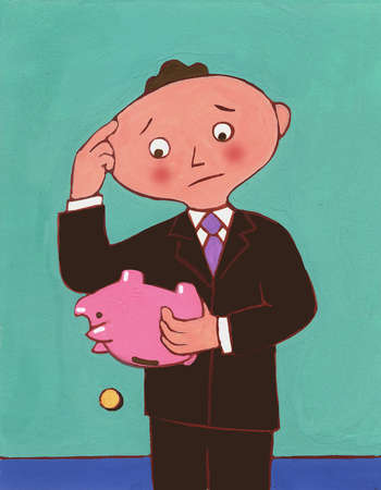 Worried businessman emptying piggy bank