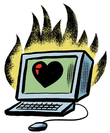Flames around heart on computer monitor