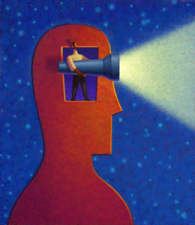 Man with flashlight standing in opening of head
