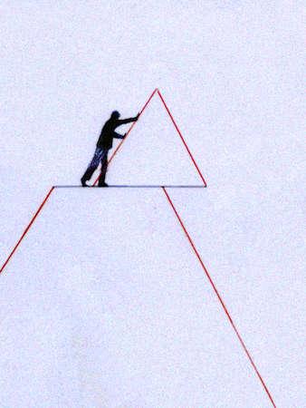 Man pushing tip of pyramid