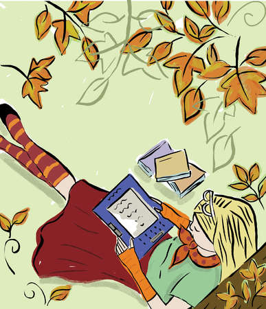 Woman reading on digital tablet outdoors in autumn