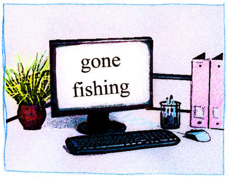 Office computer with letters that spell gone fishing