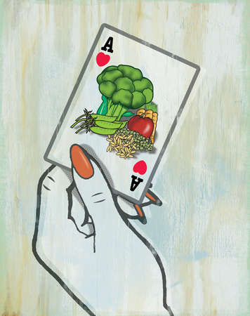 Woman holding playing card with vegetables