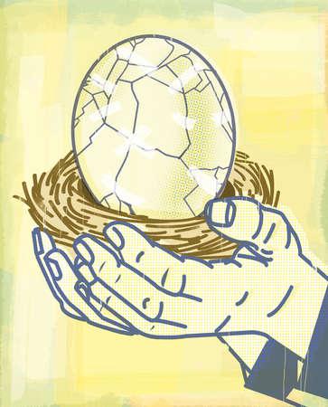 Man holding cracking egg in nest