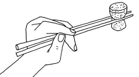 Close up of chopsticks holding cork