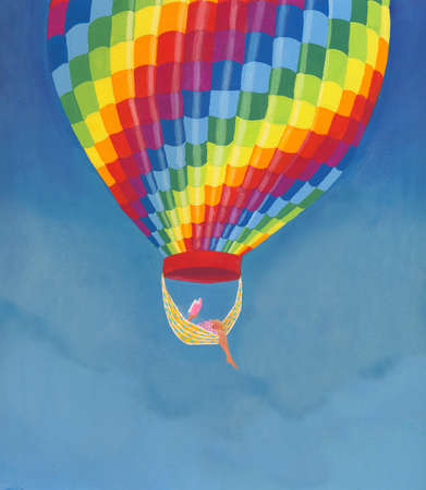 Woman reading book on hammock hanging from hot air balloon