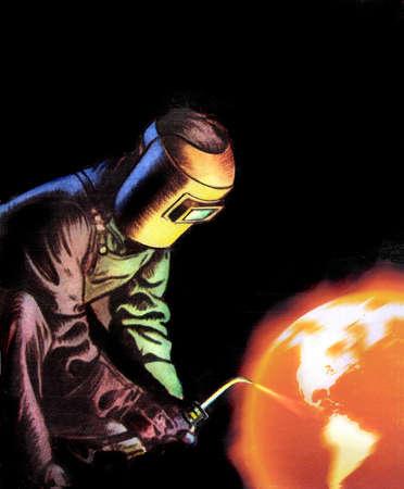 Welder welding globe