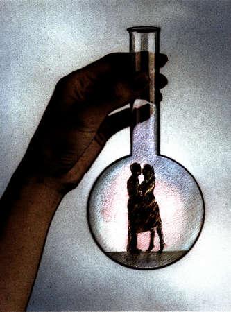 Large hand holding beaker containing couple