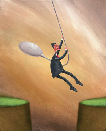 Businessman swinging from computer mouse over gap