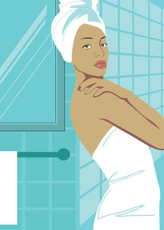 Woman wrapped in towel in bathroom