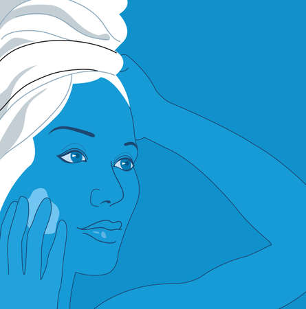 Woman with hair wrapped in towel applying moisturizer to face
