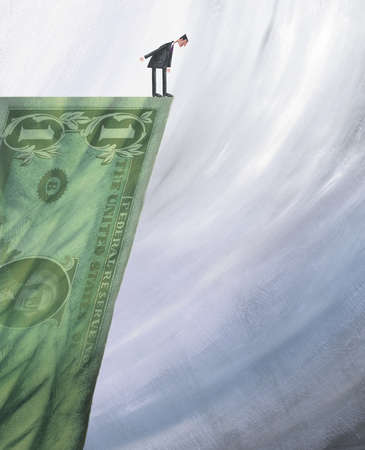 Man Standing Over a Fiscal Cliff of a One Dollar Bill