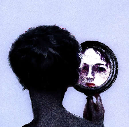 Woman looking at reflection in hand mirror