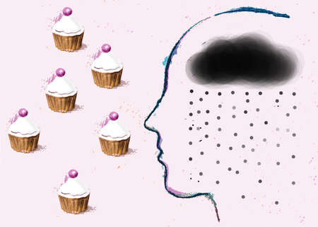 Depressed person looking at cupcakes