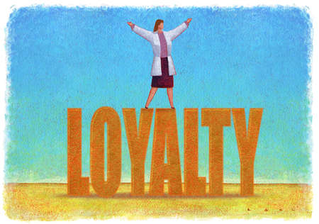 Woman standing on top of sign that says Loyalty