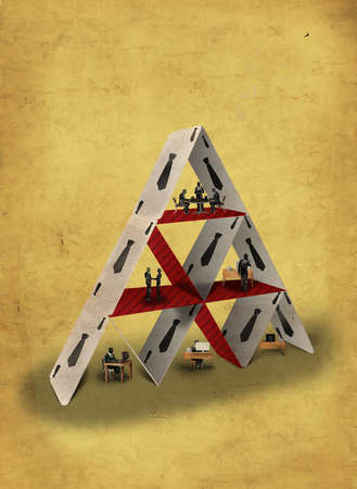 People working in a house of cards