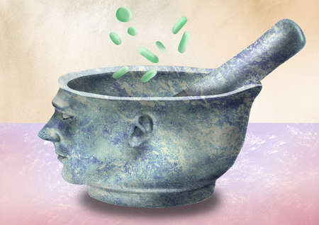 pills being added to a mortar and pestle in the shape of a man's head