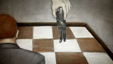 Businessman being moved on a chessboard