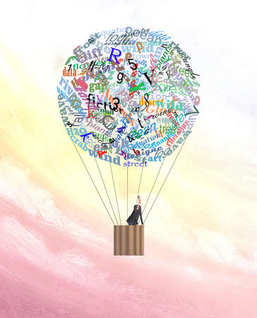 Man in hot air balloon made of words, numbers and letters