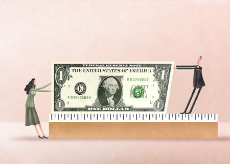 Man and woman in a tug of war with a dollar bill on top of a ruler