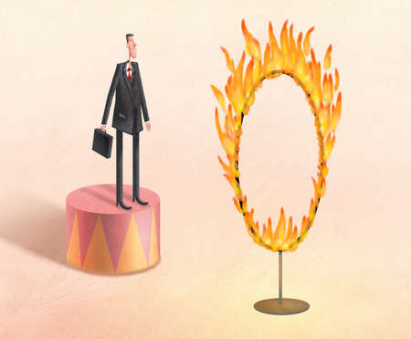 Businessman ready to jump through a ring of fire