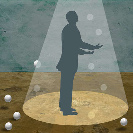 Businessman in silhouette trying to juggle under a spotlight