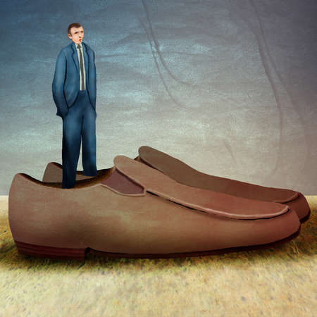 businessman standing in giant shoes