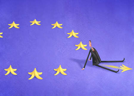 Man slipping on banana peels in the shape of the European Union Flag