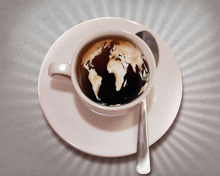 Close-up of world map imprinted in coffee representing morning coffee