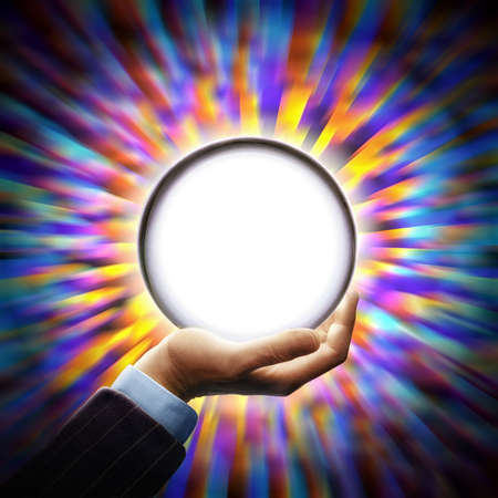 Man holding up radiant crystal ball