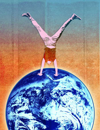 Young woman doing a handstand on planet earth