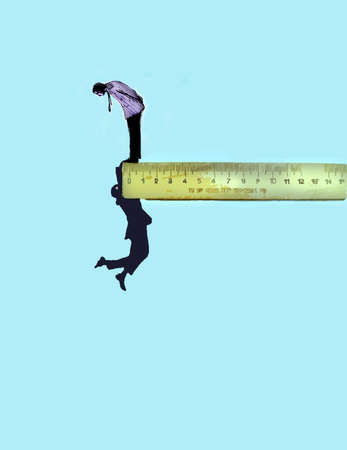 Man looking down on someone hanging on the edge of a ruler.
