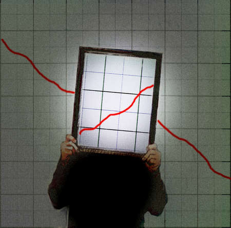 Business person holding up a chart showing growth in front of a chart showing decline.