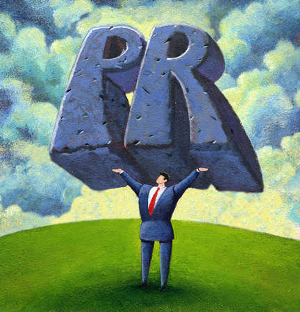 executive holding up the letters P and R