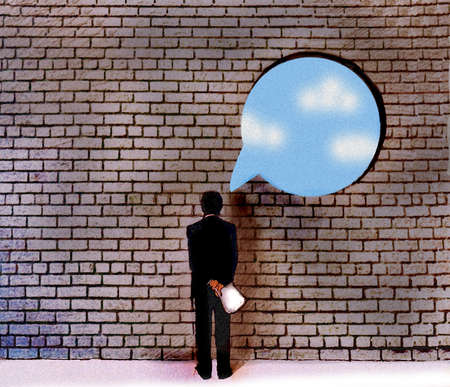 Executive looking at a brick wall with a blue sky speech bubble.