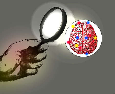 Brain being viewed through a magnifying glass