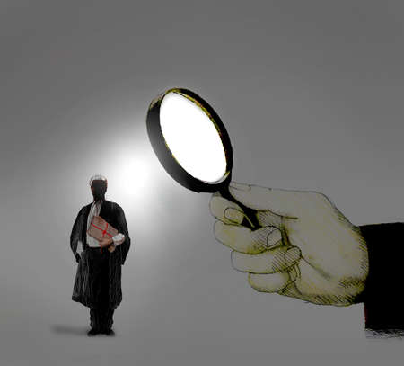 Lawyer being examined through a magnifying glass
