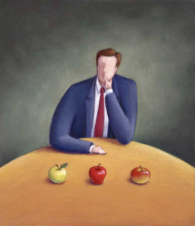 Man With Choice Of Apples